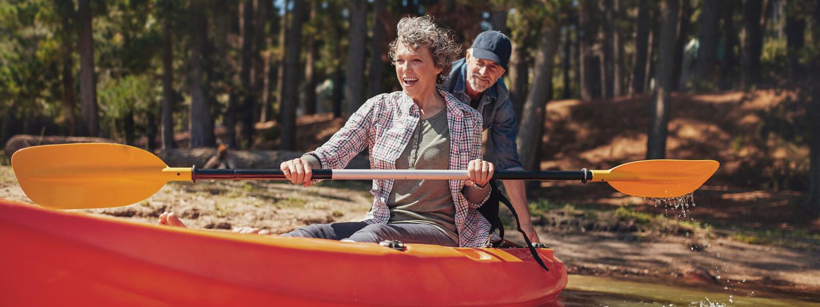 Image of couple enjoying kayaking on lake