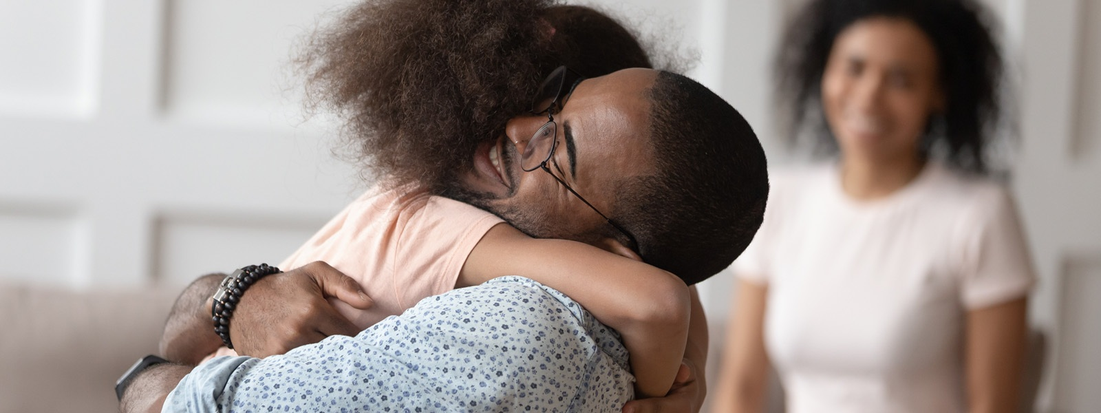 Image Of Father Hugging Daughter At Home