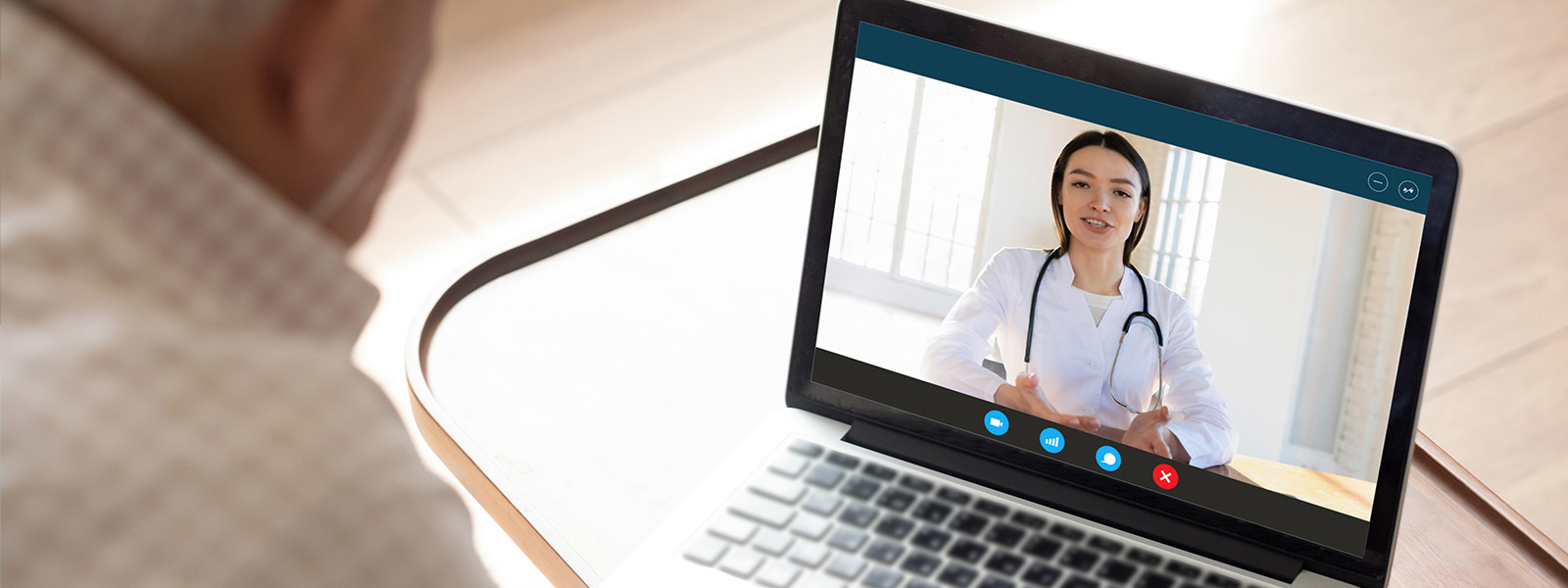 Image of patient consulting with online doctor from home
