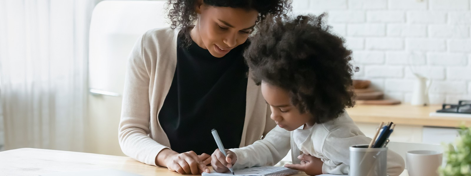 Young Girl Drawing With Her Mom