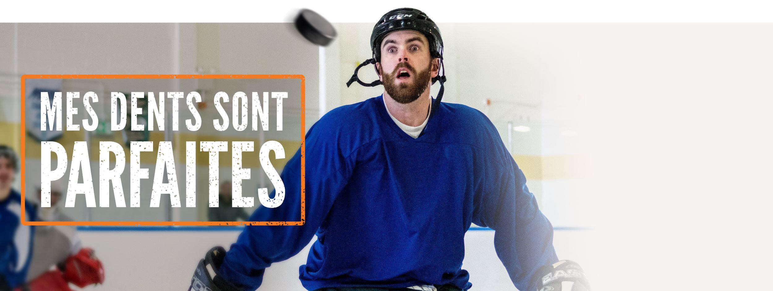 Photo d'un joueur de hockey sur le point de recevoir une rondelle dans le visage. Le texte « Mes dents sont parfaites » accompagne la photo.
