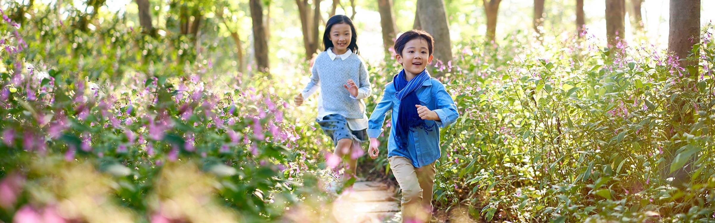 Happy children running in the forest